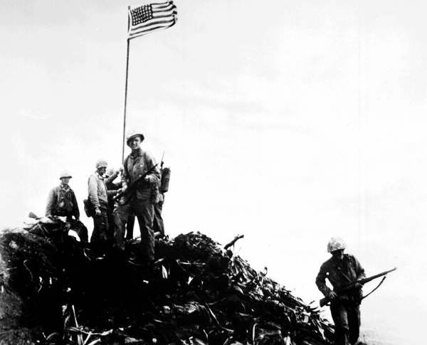 first american flag pictures. first American flag at Iwo