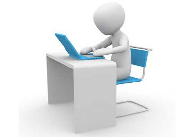 Laptop User at Desk