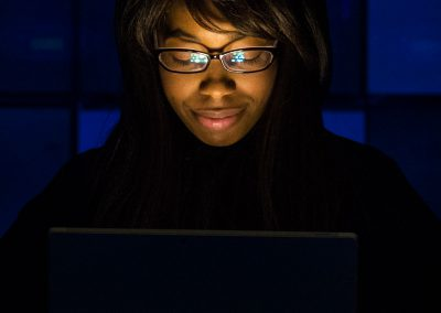 Woman's Face Illuminated by Laptop
