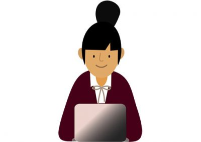 Teacher with Bun at Laptop